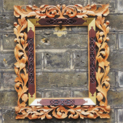 A mirror frame in the German renaissance style.  Limewood, Eucalyptus and oil gilding.